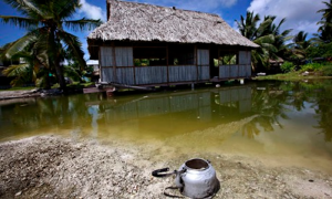 On Kiribati, an abandoned house that is affected by seawater during high tides. Photograph: David Gray/Reuters