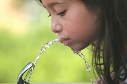 Girl Drinking Water Fountain